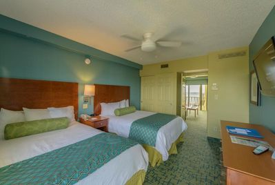 Spacious bedroom with 2 Queen size beds and flat screen TV