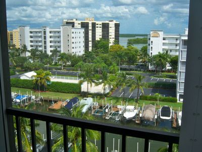 Photo for TOP FLOOR ON CANAL * WALK TO BEACH IN MINUTES * ELEVATOR * WIFI * HEATED POOL