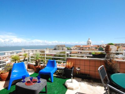 Photo for Modern flat with an unbroken view of Lisbon and the Tajo river!