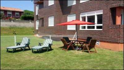 Photo for Cozy apartment with garden and barbecue in Suances, 5 pax, 2 bedrooms, bathroom and toilet
