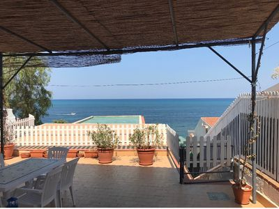 """Photo for """"Scirocco"""" apartment with direct access to the beach"""