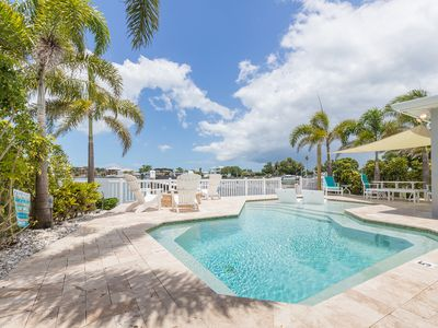 Photo for Waterfront home with heated pool, private boat dock & golf cart - SLEEPS 10