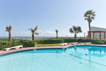 Photo for Beachfront Bargain with Views of the Bay! Heated Pool Overlooking the Beach!