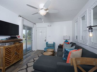 Den offers flat screen TV and sliding doors to private patio and sand dune views