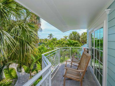 Photo for Tropical Breeze Resort - Private Balcony. Pool View. Sleeps 6. Steps to Siesta Key Beach and Village - INCLUDED: Daily Housekeeping, Bikes, 2 Pools/1 Spa, Beach Chairs, Beach Towels, WiFi, Parking , Games, BBQs and More!