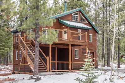 Exterior - Welcome to Truckee! Your rental is professionally managed by TurnKey Vacation Rentals. This property is nestled in a scenic pine tree backdrop.