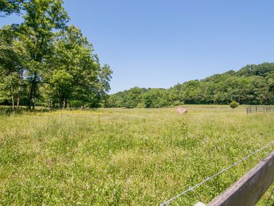Photo for 22-Acre Suburban Paradise w/ 3BR, Wildlife & Huge Deck, 17 Miles to Downtown