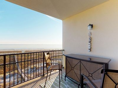 Photo for Gulfside upper-level condo with shared pool and hot tub moments from the beach