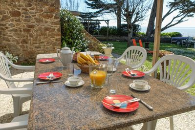 dinning table with sheltered terrace outside the kitchen