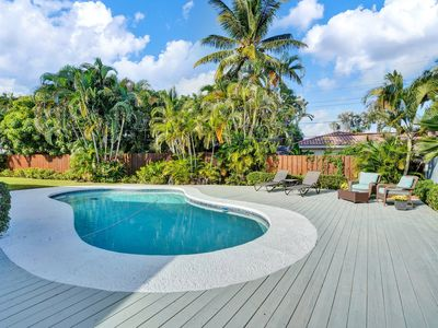 Photo for Lovely 3 bedroom home neslted in Coral Ridge with sun soaked pool