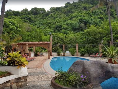 Photo for Your  jungle wrapped hideaway, minutes from Zona Romantica!