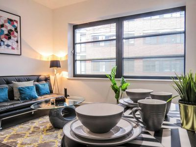 Photo for Modern design spacious studio apartment with private bedroom area