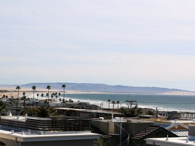 Photo for New Downtown Condo with Roof Top Patio, Ocean views, 1 ½ blocks from ocean!