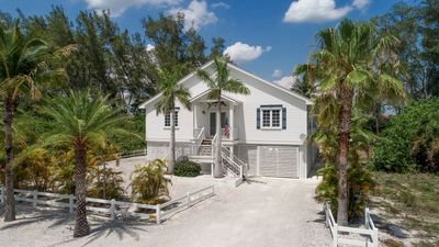 Photo for Ultimate 3 bedroom beach house compound with private pool and dock!