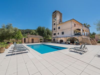 Photo for This 7-bedroom villa for up to 12 guests is located in Selva (Majorca) and has a private swimming po