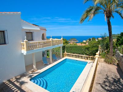 Photo for This 4-bedroom villa for up to 8 guests is located in Javea and has a private swimming pool, air-con