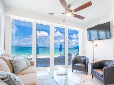 Photo for Unique Oceanfront Condo on 7-Mile-Beach with Patio. Cayman Reef Resort # 22