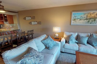Plenty of comfortable seating overlooks the large flat screen TV.  Plenty of room for 6.