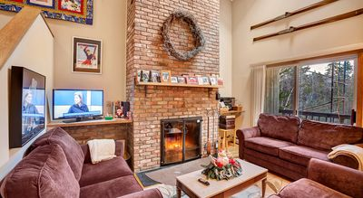 Living room with wood burning fireplace to keep you warm even on the coldest days