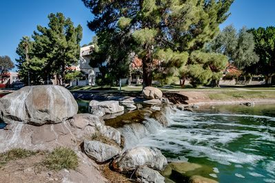 Enjoy the community waterfall as you stroll around the lake