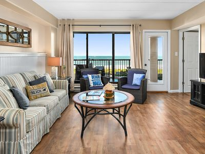 Beautiful 2-bedroom oceanfront condo with gorgeous hardwood flooring, free WiFi, and an outdoor pool located uptown with direct access to the beach!