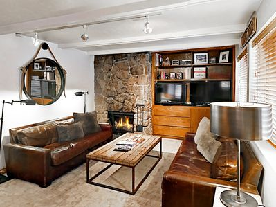 Living Room - Deep leather couches, a fireplace with stone surround, and an entertainment center make this the ideal place to get cozy with loved ones.