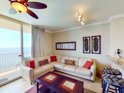 Photo for Elegant gulf-front condo w/ pools, hot tubs & beach service - near Pier Park!