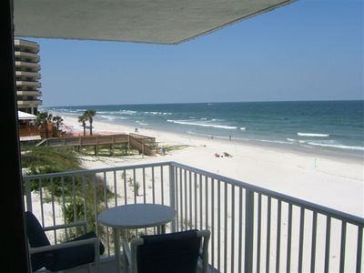 Slide open the door, step out on to the 'wrap around balcony,' enjoy the view