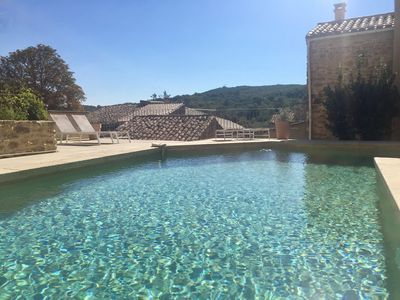 Photo for Charming house in a village 15 km from Uzès, heated pool, dominant view