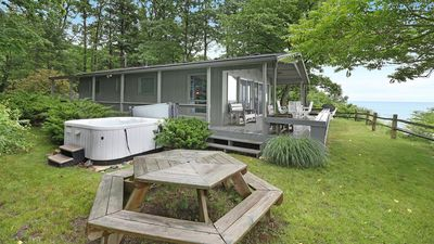 Photo for Lakefront Cottage w/ Views from the Hot Tub; 3 Night Min All Summer