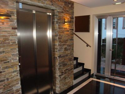 Lobby with elevator.