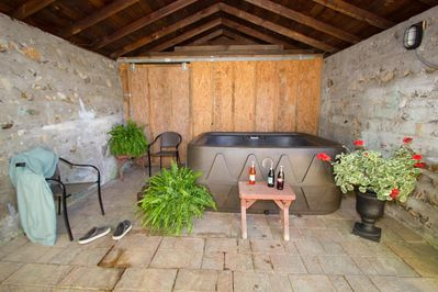 Sheltered outdoor hot tub, just steps from the back door.  Soak your cares away.