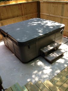 The new Hot Tub with an easy to remove hinged lid and privacy fence!