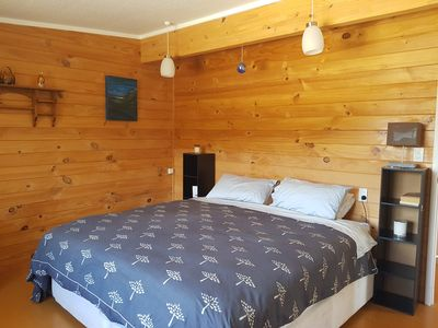 Photo for Peaceful open plan cottage in Orongo Bay, Russell.
