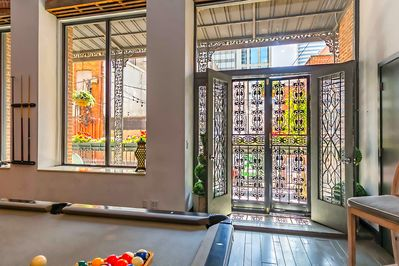 Doors to the large terrace overlooking Printers Alley from the Pool table room