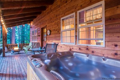 Front porch includes private hot tub, propane fire pit and eating table