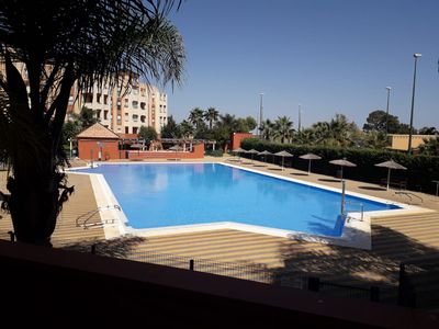 Photo for Apartment with magnificent terrace overlooking the pool, 100 meters from the beach