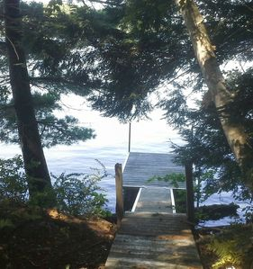 The path slopes down through the woods to the dock.  We'll provide the chairs :)