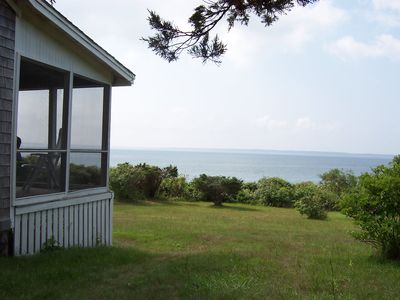 Photo for Nostalgic 1920's Cottage With Private Beach And Best Sunset Viewing On Island