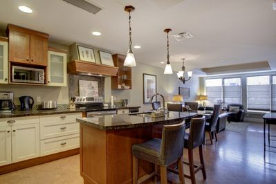 The gourmet, eat-in kitchen is fully stocked and features stainless steel appliances.