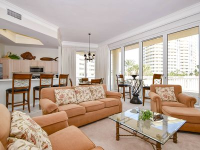 Photo for Large lobby-level end condo w/patio access to beach & pool!