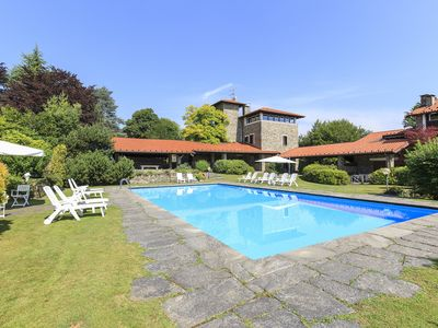Photo for Stylish awesome house with lake view, pool and garden on the hills above Stresa