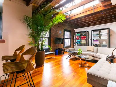 Photo for Sunny SoHo loft in NYC historic Cast Iron District - available from 1/4/19