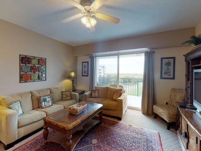 Photo for NEW LISTING! Lakefront condo with shared pool/spa with a short walk to the beach