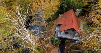 Arial view taken from Drone camera shows house proximity to river.