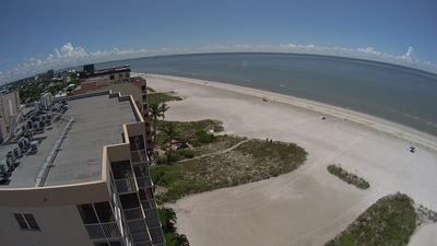 Aerial view over top of building looking south at beach
