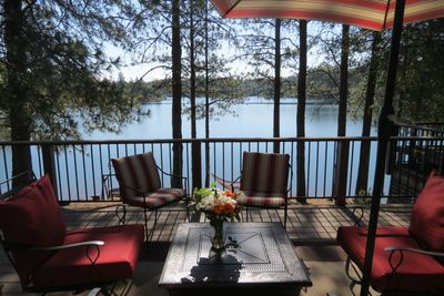 Sit, relax, and enjoy the beautiful view of Lake Combie from the cottage deck