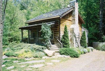 This cabin is in a postcard like setting.