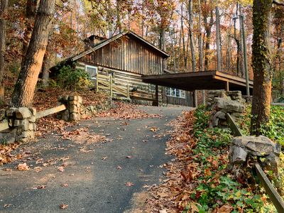 Photo for This historic cabin is nestled in the woods only minutes from town.