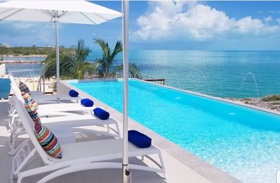 Photo for OCEANFRONT LUXURY. BUTLER & CHEF. 50 FEET FROM THE SEA. GLASS WALLED POOL. BEACH